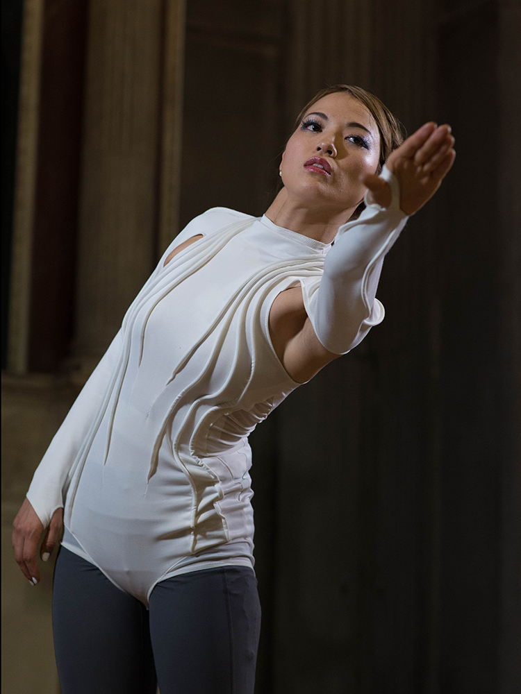 Dancer wearing interactive garment